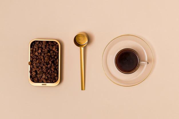 Coffee beans and black coffee Free Photo