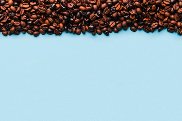 Coffee beans on blue Free Photo