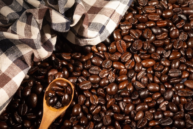 Coffee beans on brown linen fabric Premium Photo