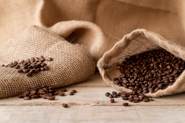 Coffee beans in burlap sack front view Free Photo