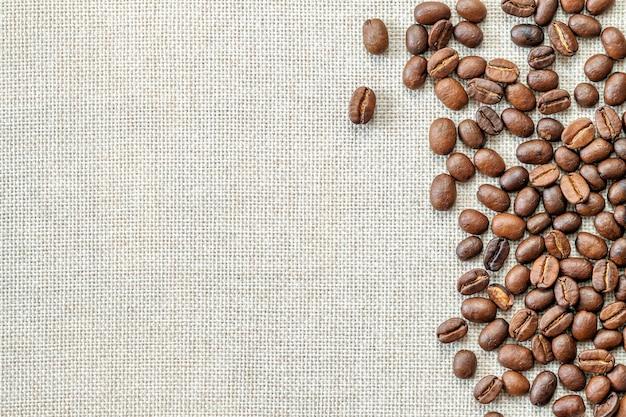 Coffee beans on cloth background. Premium Photo