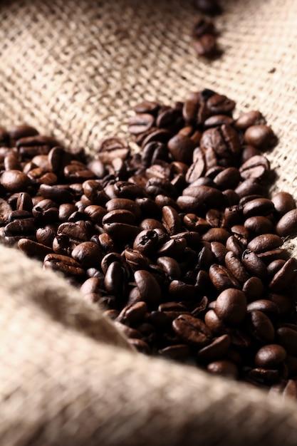 Coffee beans on cloth sack Free Photo