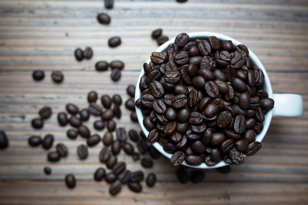 Coffee beans in coffee cup. Free Photo