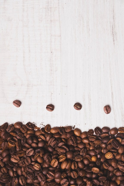 Coffee beans composition on white Free Photo