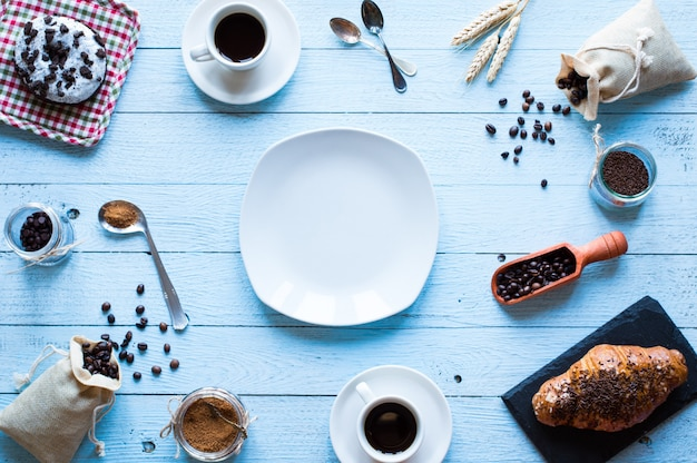 Coffee beans and cup of coffee, breakfast top view Premium Photo