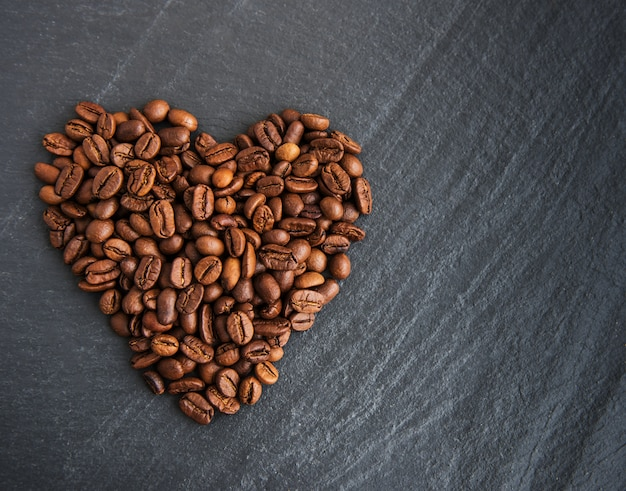 Coffee beans in the form of heart Premium Photo