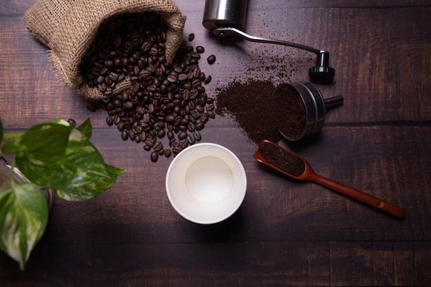 Coffee beans and ground powder  with coffee cup Free Photo
