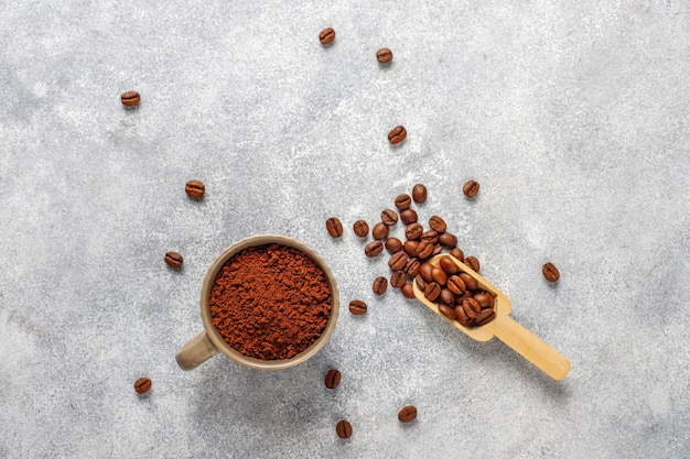Coffee beans and ground powder. Free Photo