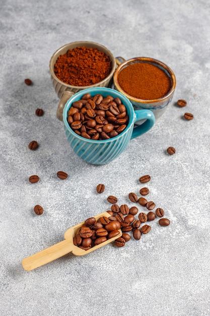 Coffee beans and ground powder. Free Photo
