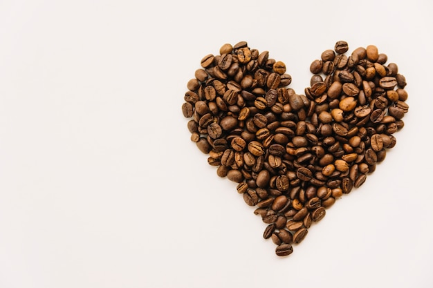 Coffee beans in heart form Free Photo