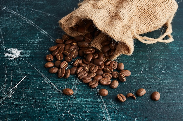 Coffee beans out of a rustic pocket. Free Photo