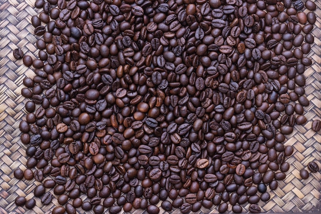 Coffee beans placed on wooden tray, distribution of coffee beans. Premium Photo