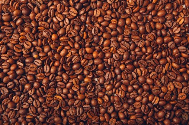 Priorità bassa di vista superiore dei chicchi di caffè Foto Gratuite