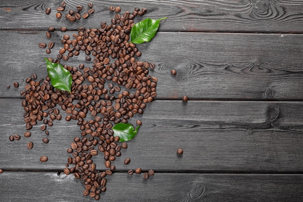 Coffee beans on wood background Premium Photo