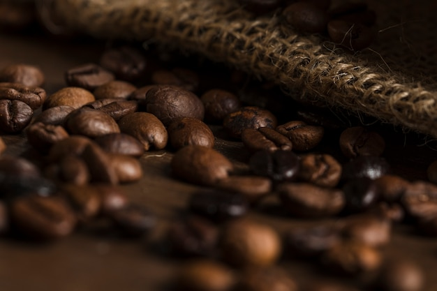 Coffee beans on wooden desk Free Photo