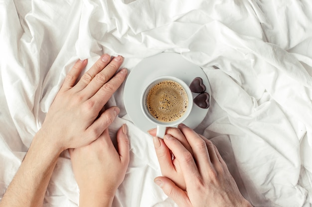 Coffee in bed. selective focus. hot drink. Premium Photo