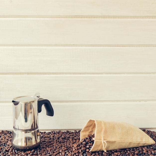 Coffee composition with moka pot and bag Free Photo