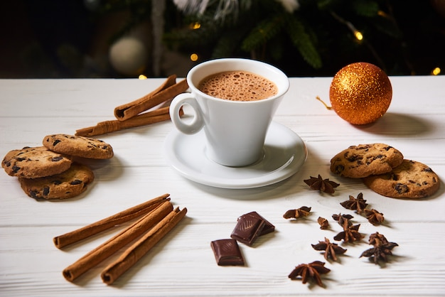 Coffee and cookies on the white table at christmas Premium Photo