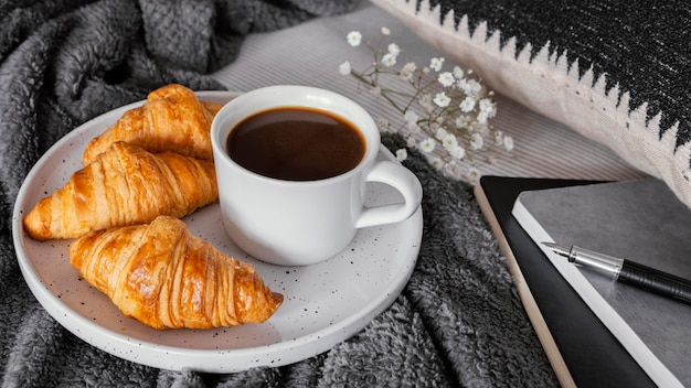 Coffee and croissants for breakfast Free Photo