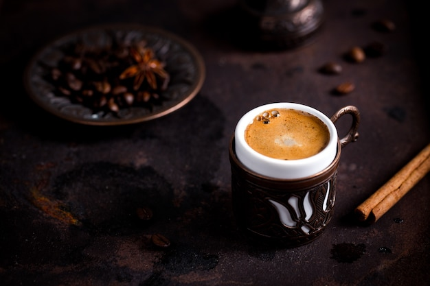 Coffee cup and beans on old kitchen table. turkish coffee and turkish delight with copyspace Premium Photo