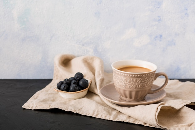 Coffee cup and blueberries Free Photo