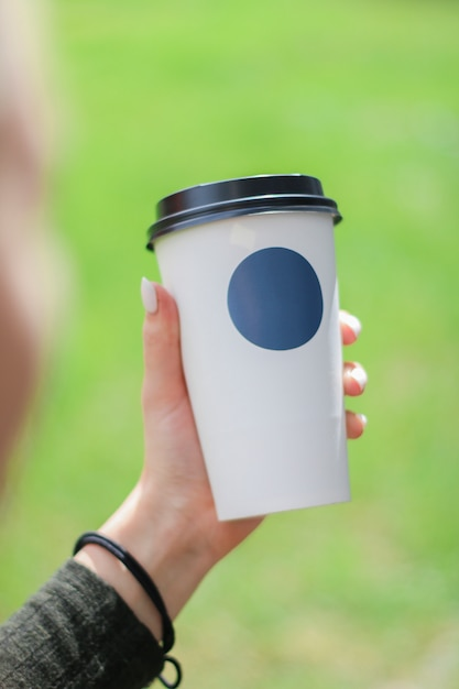 Coffee cup to go concept with place for your logo Premium Photo