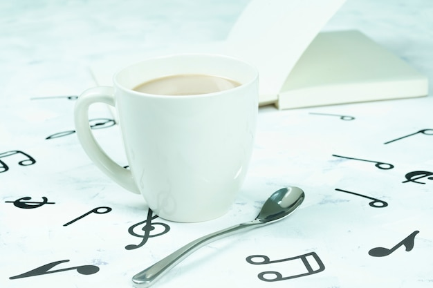 Coffee cup placed on the floor, musical note pattern Premium Photo