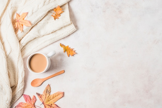Coffee cup and sweater autumn frame Premium Photo