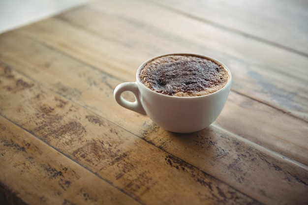 Coffee cup on a table Free Photo