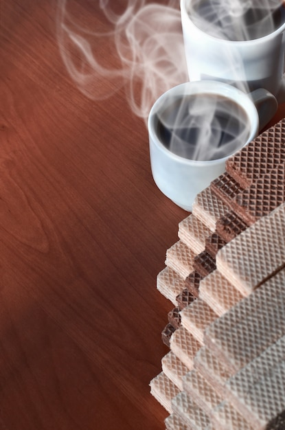 Coffee cup and waffels Premium Photo