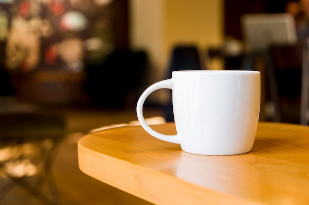 Coffee cup with blurred background Premium Photo