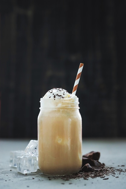 Coffee cup with caramel and whipped cream Free Photo