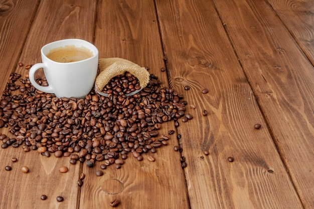 Coffee cup with coffee bag on wooden table. view from top Premium Photo