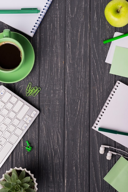 Coffee cup with notebook and succulent plant on wooden desk Free Photo