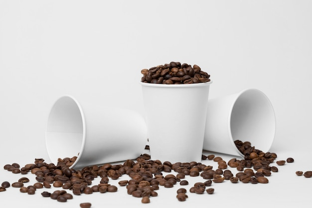 Coffee cups with coffee beans arrangement Free Photo