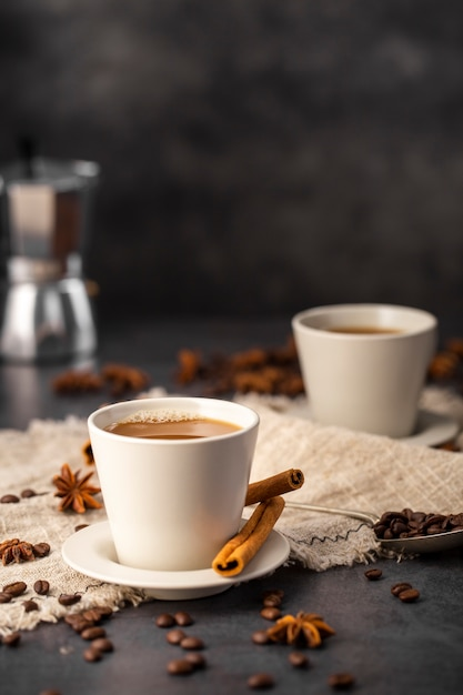 Coffee cups with ingredients Free Photo