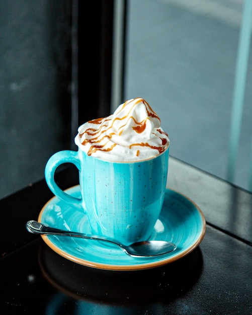 Coffee drink with whipped cream and caramel syrup Free Photo