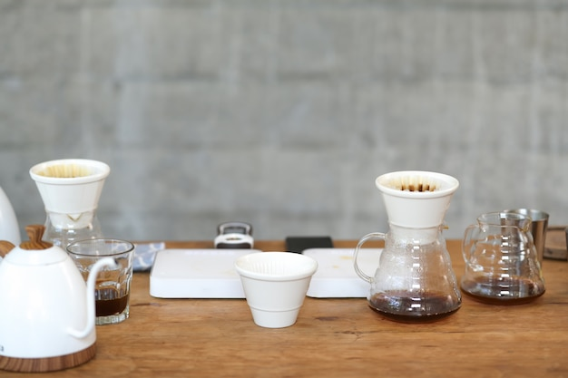 Coffee drip and accessories on the table Premium Photo