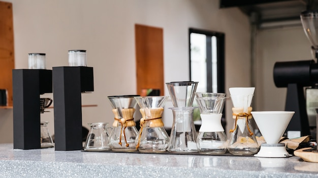 Coffee equipments with various sizes of drip coffee cups Premium Photo