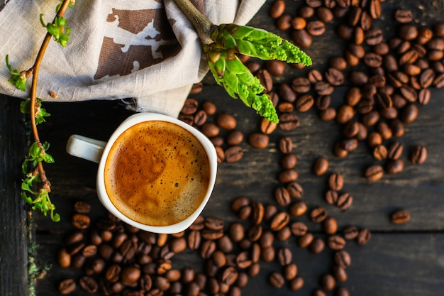 Coffee freshly brewed in a white cup serving of beverage (coffee grain). food. top.copy save Premium Photo