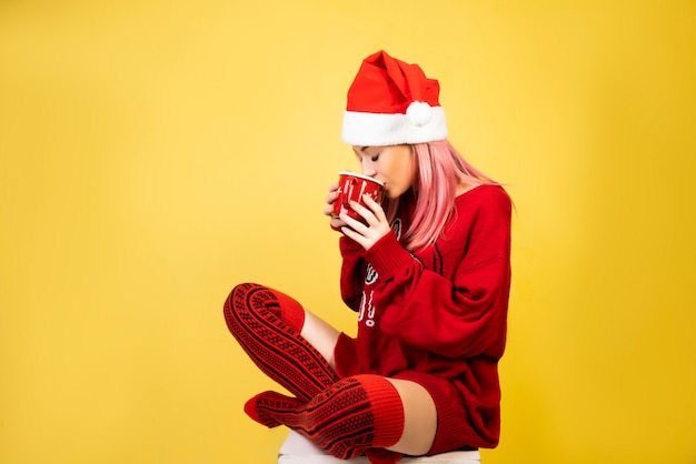 Coffee girl with red santa hat Free Photo