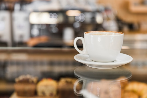 Coffee over glass cabinet in shop Free Photo