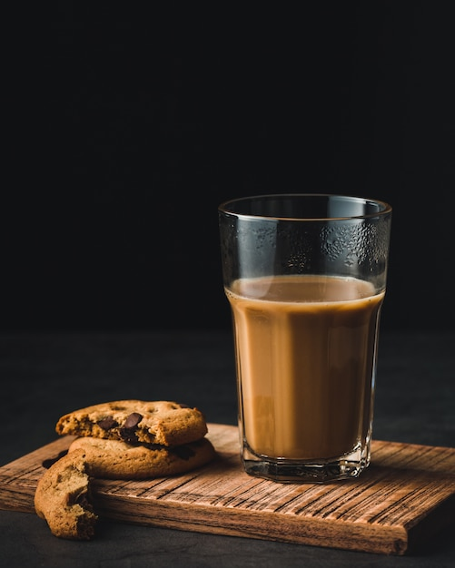 Coffee glass cup and cookies with chocolate Free Photo