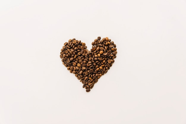 Coffee grains in heart form Free Photo
