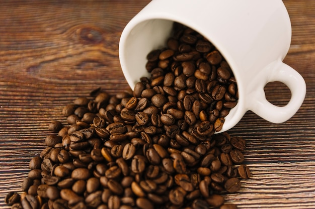 Coffee grains scattering from cup Free Photo