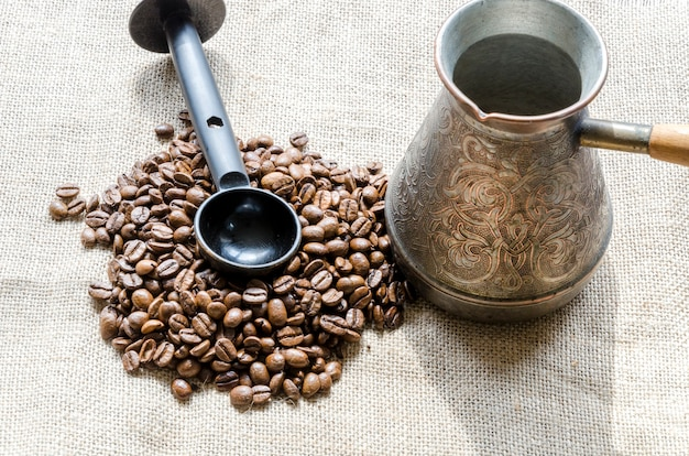Coffee grains with tool Free Photo