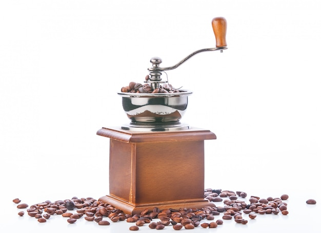 Coffee grinder and coffee beans isolated on white background Premium Photo