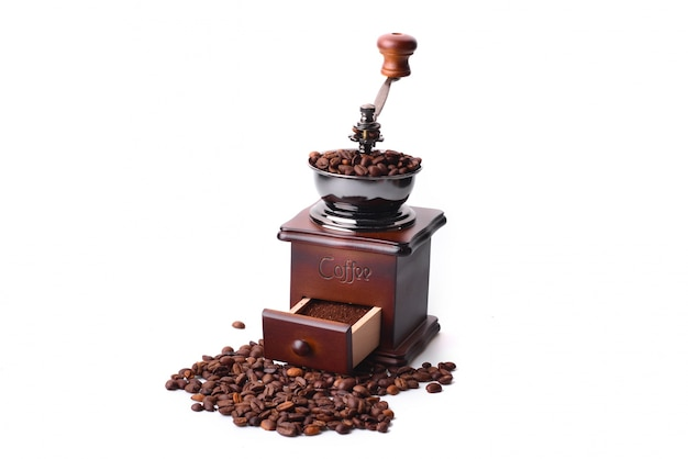 Coffee grinder on white background Free Photo