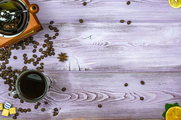 Coffee grinder with coffee beans Premium Photo