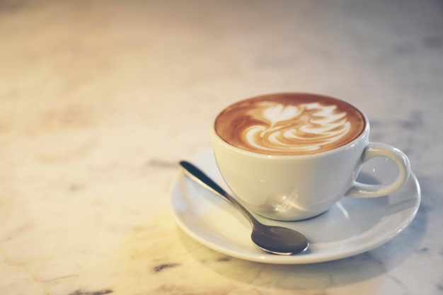 Coffee latte art, vintage filter image Premium Photo